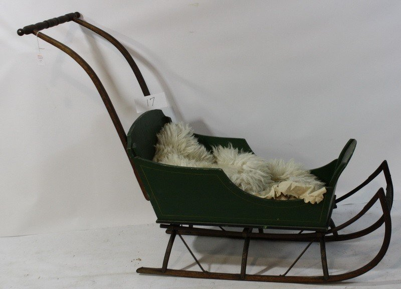 17: Green painted push sleigh