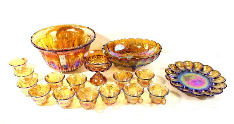 62: Marigold carnival glass set with punch bowl, footed