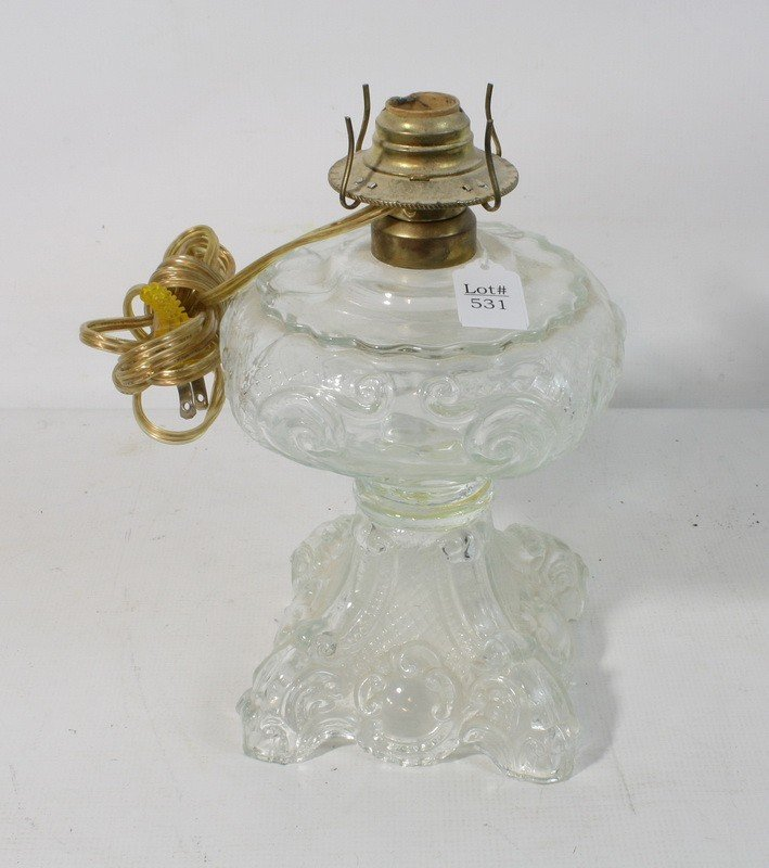 531: Clear glass base lamp without shade or top