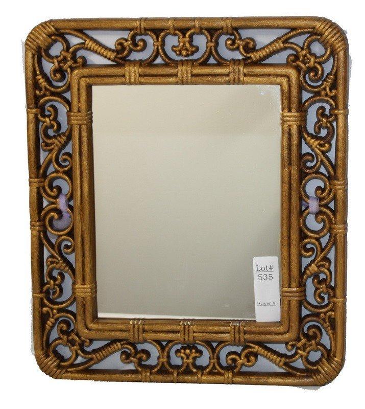 535: Brown plastic frame around mirror 12x14