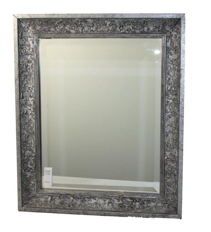 536: Silver in color decorative framed mirror 21x25