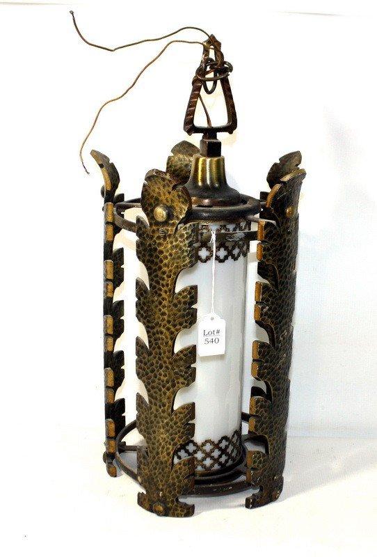 540: Hanging metal light with decorative gold surroundi
