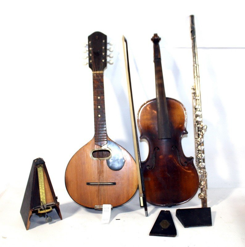 669: Box of instruments to include one stringed instrum