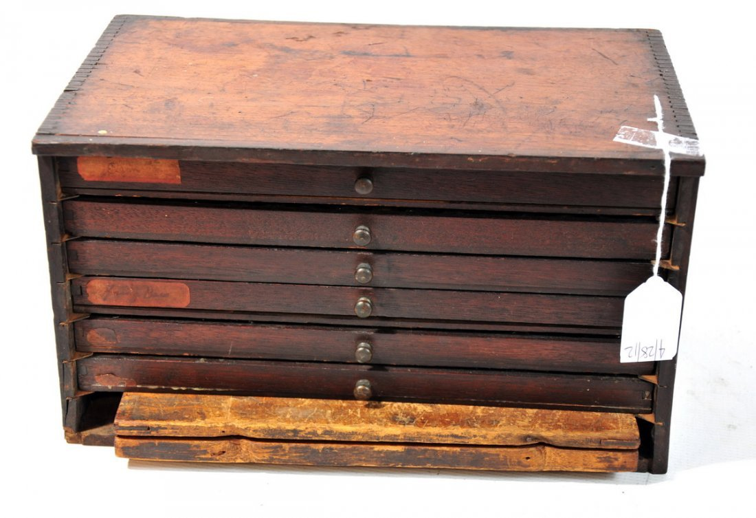 42B: 19th Century Walnut cabinet with watch parts in vi
