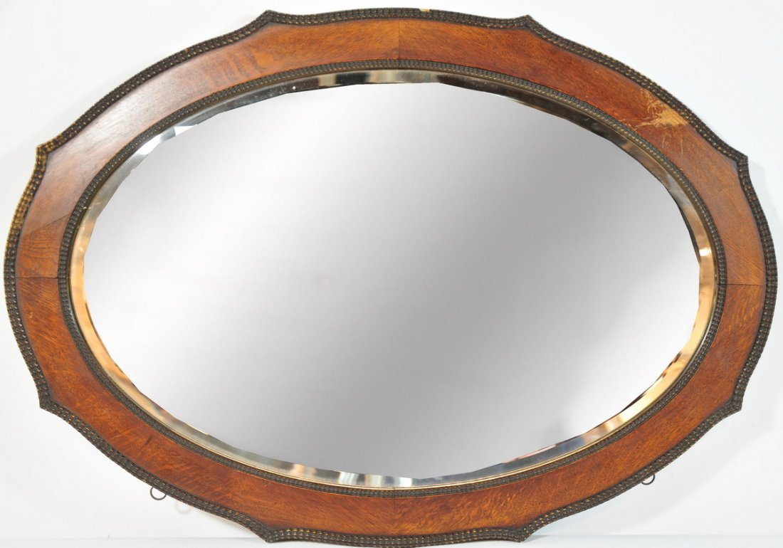 43A: Oak Oval Beveled glass mirror 33x23 with intricate