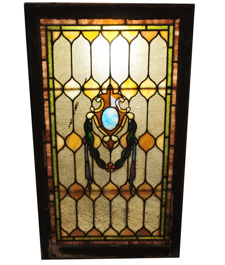 45: Stained glass window 42x24 with some damage to cent