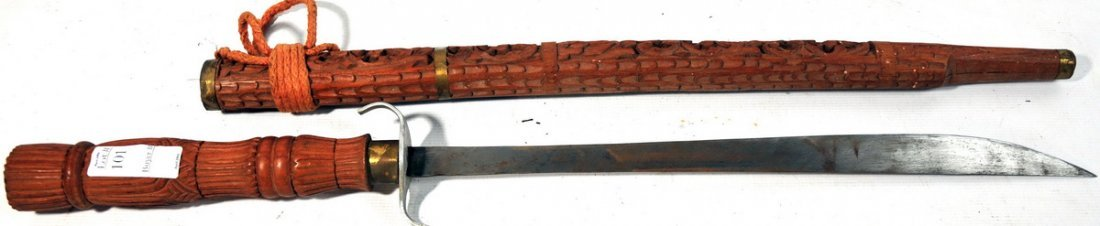 101: Decorative sword in wooden sheath