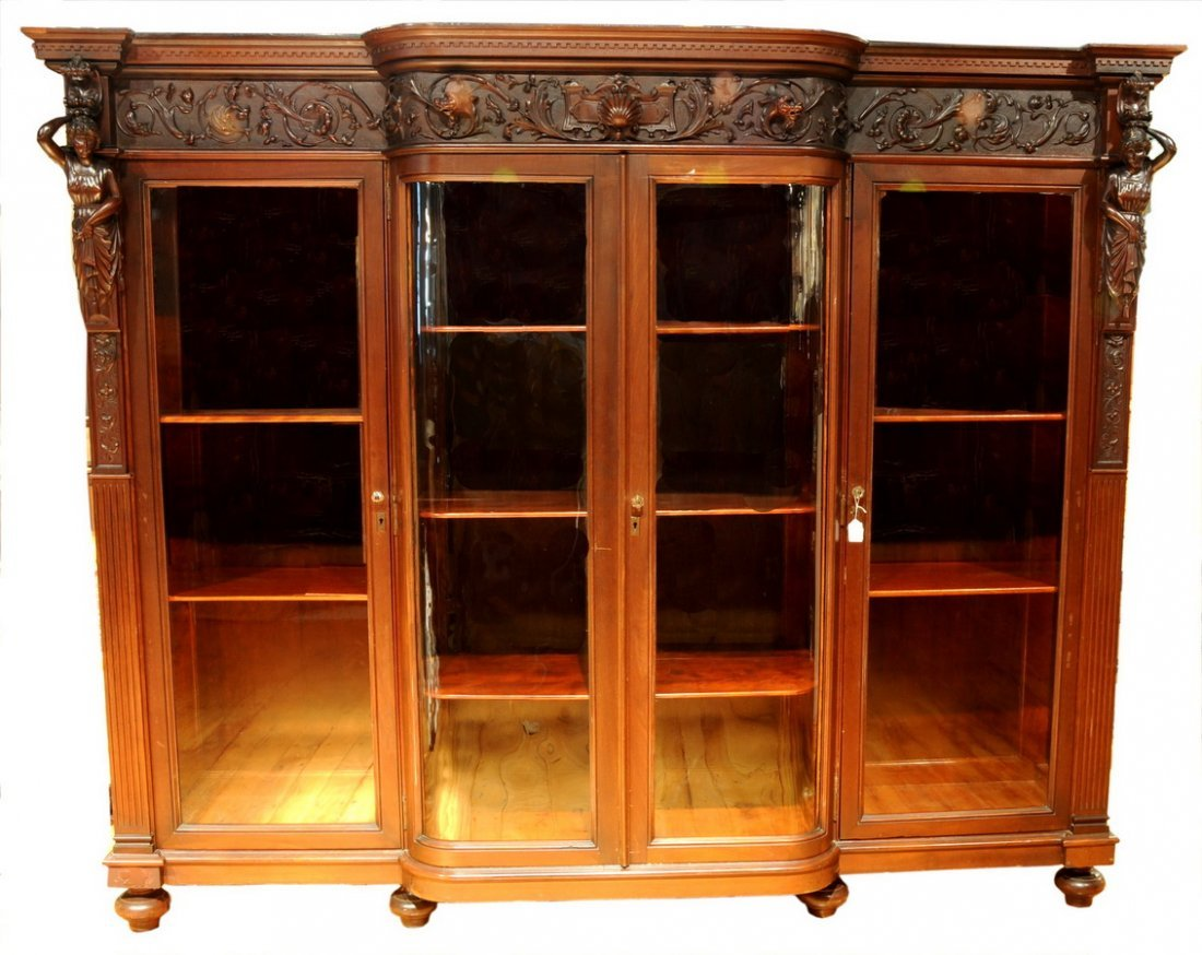 13: Carved Mahogany curved door bookcase with carved ch