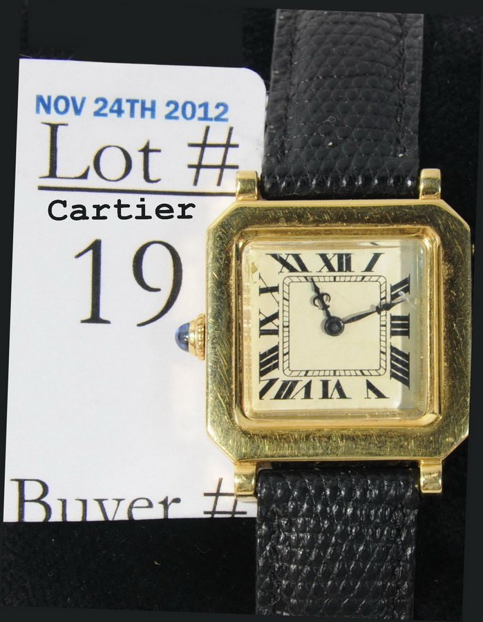 19: 18Kt. Cartier Wrist watch with leather band, 18kt.