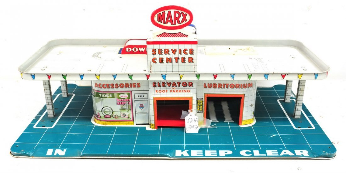 Two Tin Toys Garages Marx and Superior Toy Company