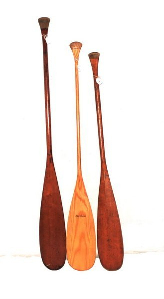 Three old town canoe paddles