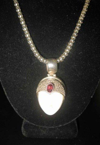 40: Sterling Silver Chain with Face Form Pendant