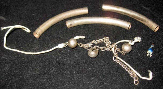 1: Pieces to a White Metal Necklace
