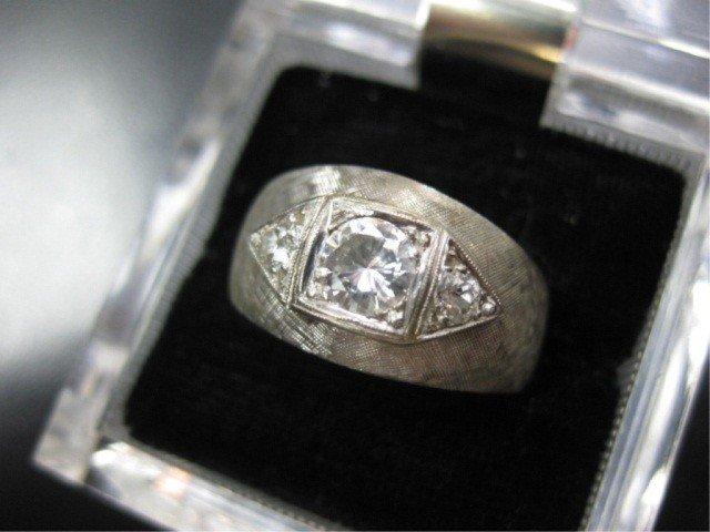 13: Man's 14K White Gold Diamond Ring
