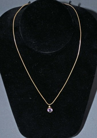12: 14K Gold Amethyst and Diamond Pendant on Chain