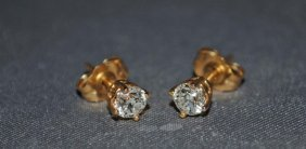 Pair Of 14K Gold Diamond Stud Earrings