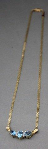 3: 14K Gold Blue Topaz and Diamond Necklace