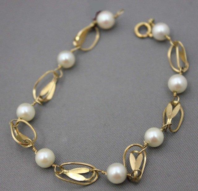 7: 14K Gold Pearl Bracelet