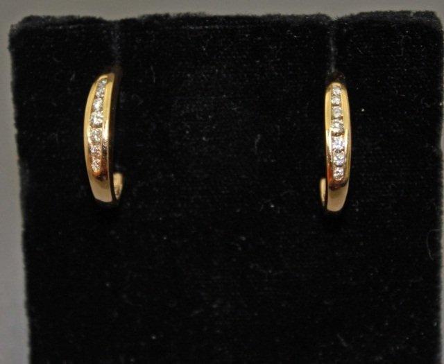 20: Pair of 14K Gold Diamond Earrings