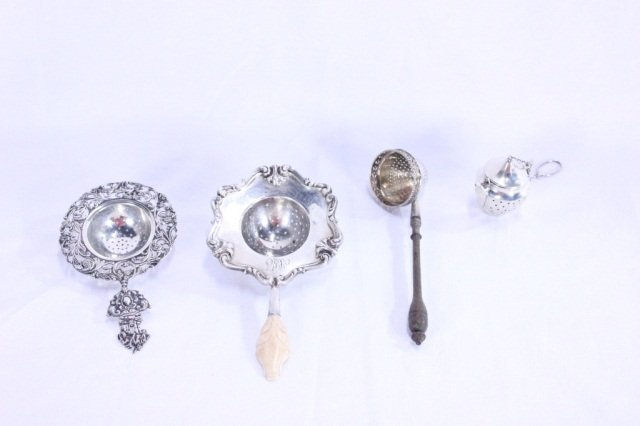 14: Group of Four Tea Strainers