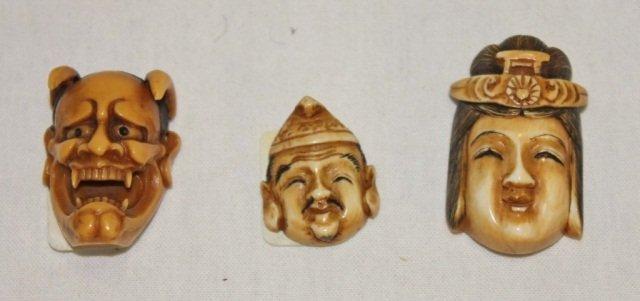 21: 3 Oriental Ivory Masks