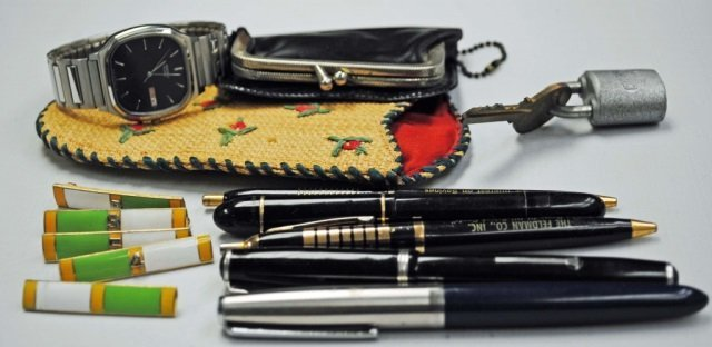 Assorted Pens and Trinkets