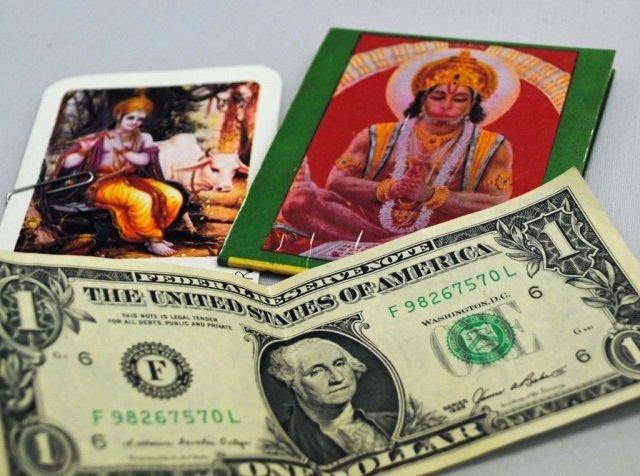 $1, Hindu Prayer and Calendar