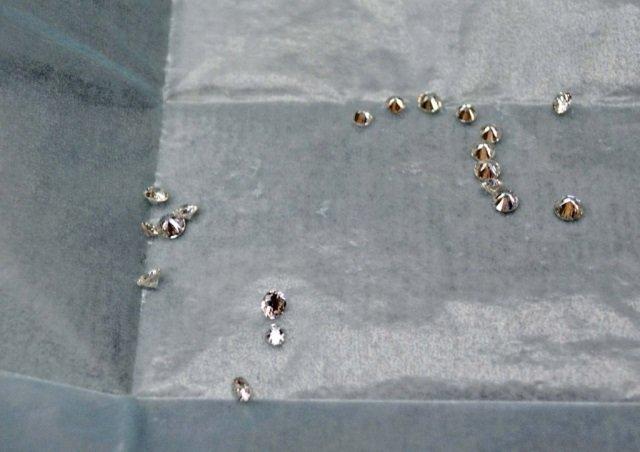 19 Unset Round Brilliant Cut Diamonds