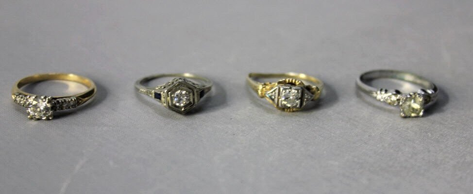 Three 14kt Gold Rings and One Costume Ring