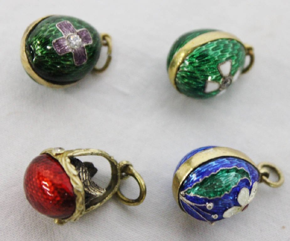 Four Golden Enamel Russian Egg Pendants
