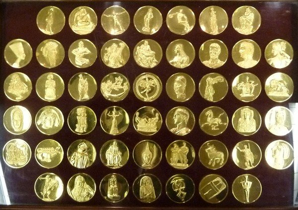 1203: WORLD World 24KT Gold Electroplate On Bronze of t