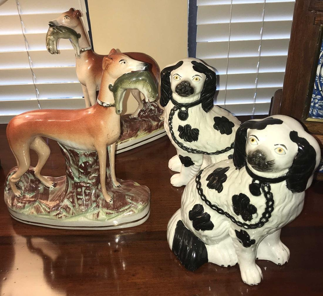 4 Antique Staffordshire Dogs.