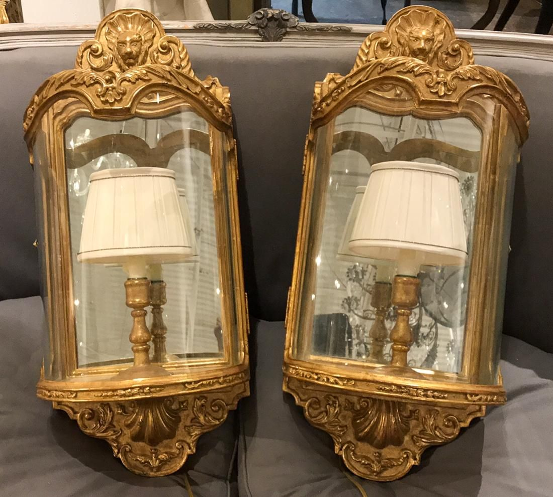 Pair of mirrored sconce behind glass