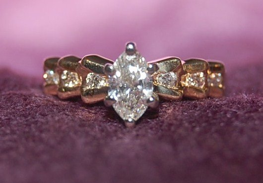 9: 14k Diamond Ring w/ Marquis Center approx. 1/2 ctw.