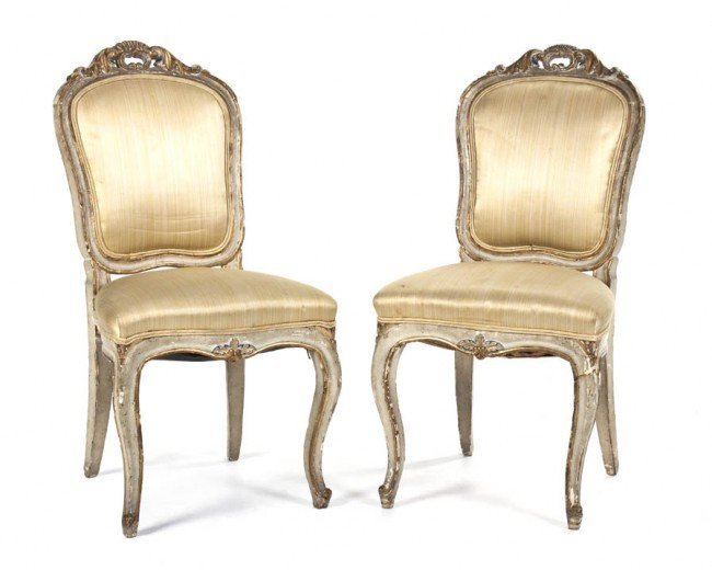 Pair of antique Rococo parcel gilt side chairs