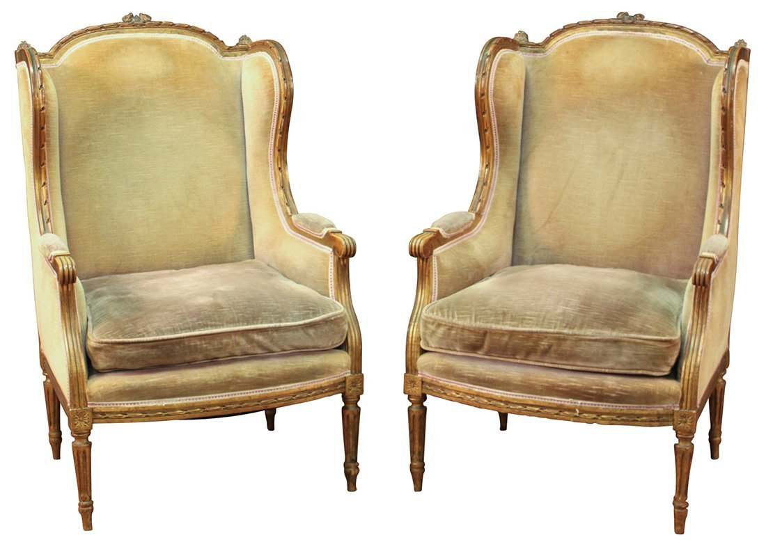 A Pair Of French Gilded Louis XVI Wing Chairs