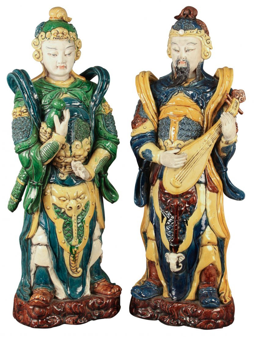 A Pair Of Glazed Pottery Oriental Figures