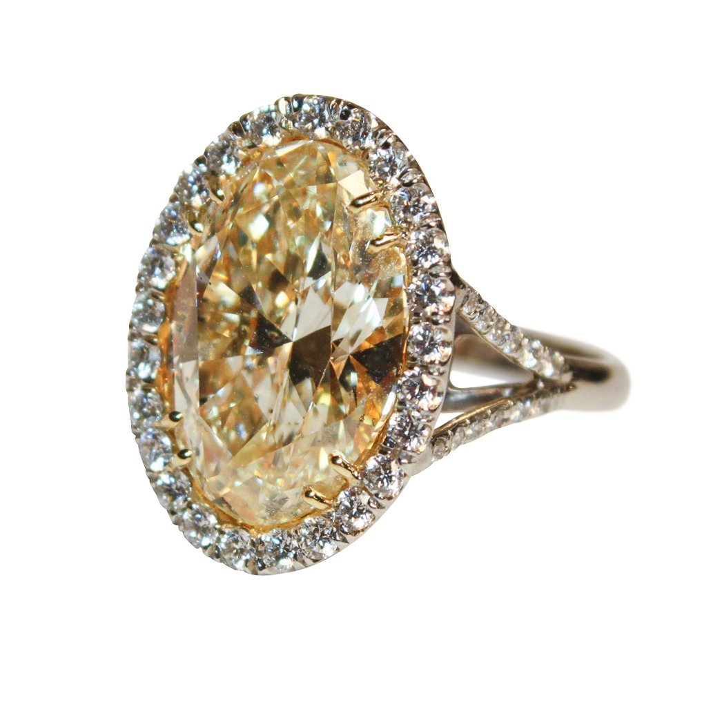 10.09ct  Fancy Yellow , Si2 Oval Diamond With