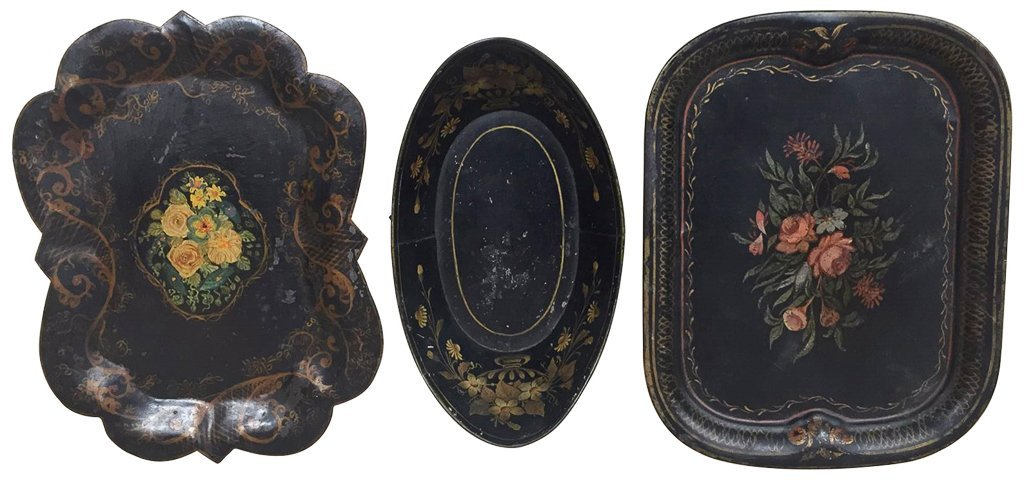 A Group Of Three Black Tole Trays