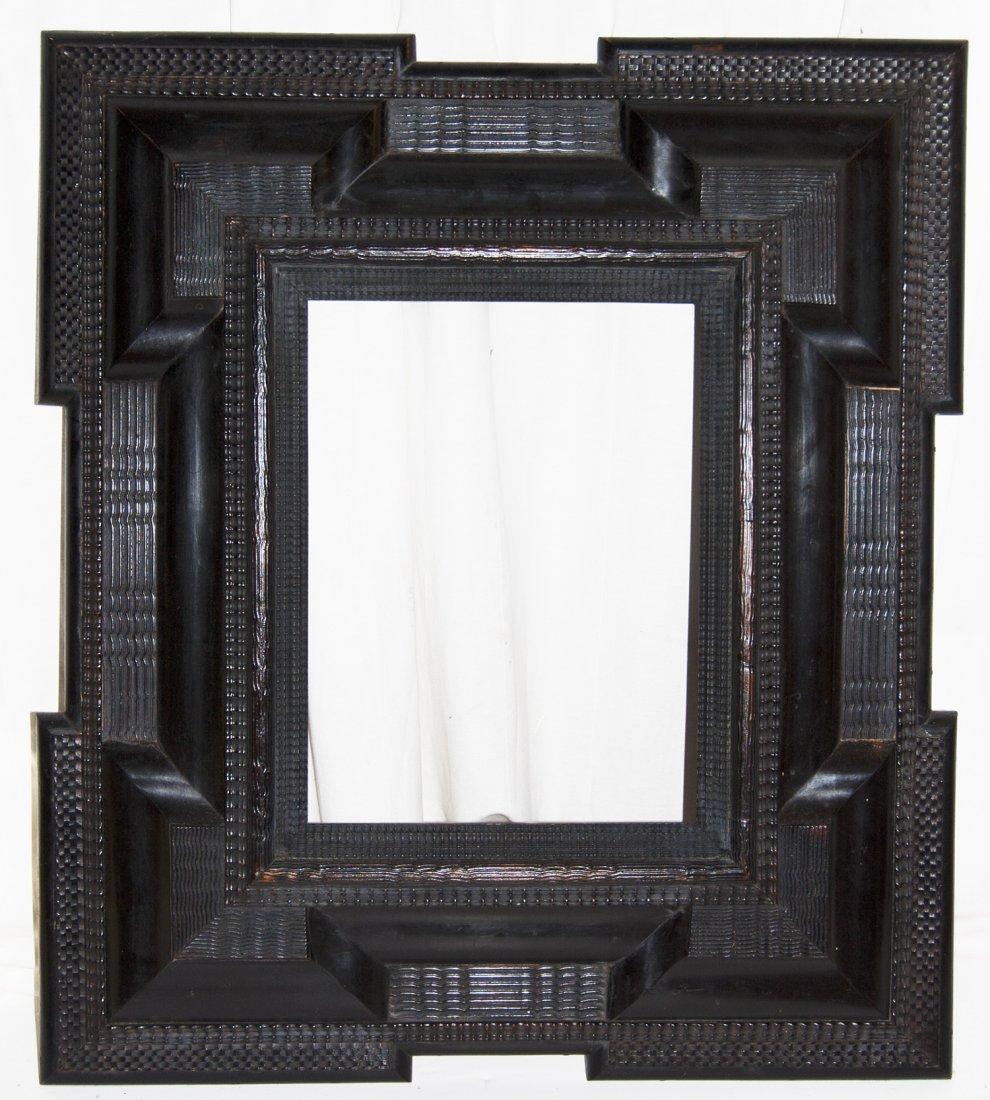 Dutch 18th C. hand carved and ebonized ripple frame