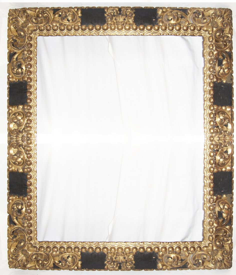 Very large Spanish 17th C. hand carved and gilded frame