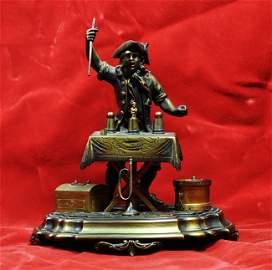 34: BRONZE, MAGICIAN DESK SET. Cast bronze