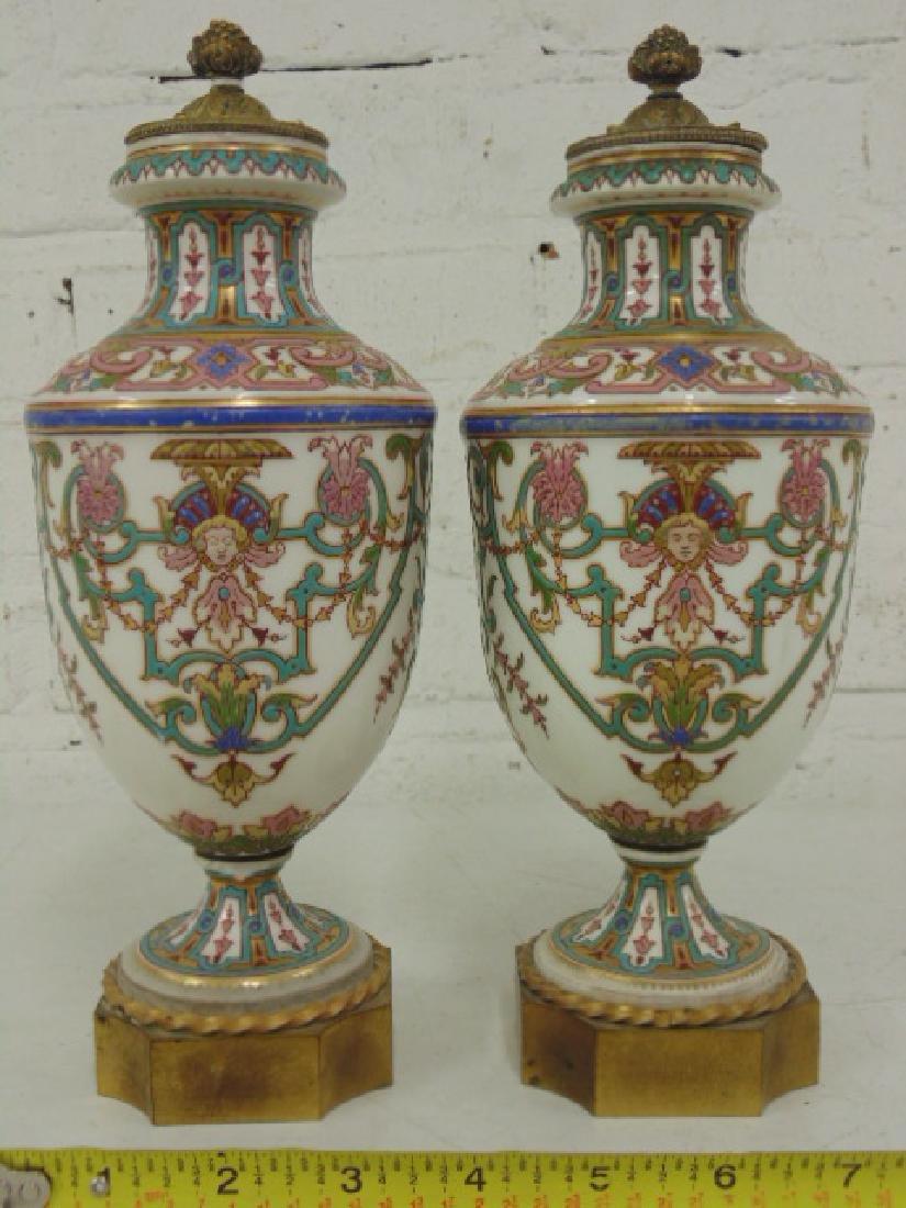 Pair small porcelain & bronze urns