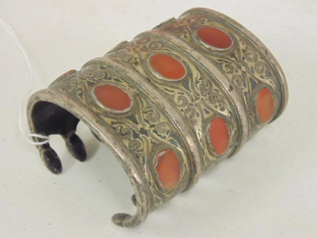 Silver cuff inlaid with stones