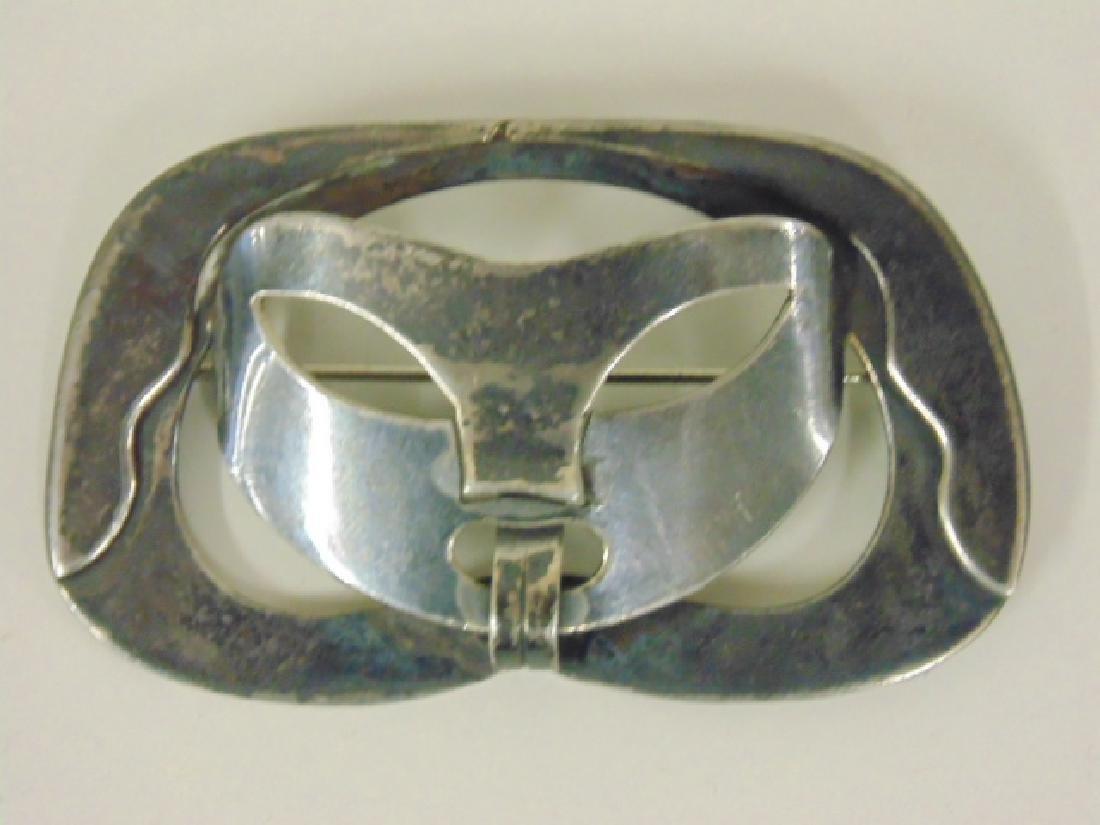 Sterling silver pin, mask, signed Paul Lobel