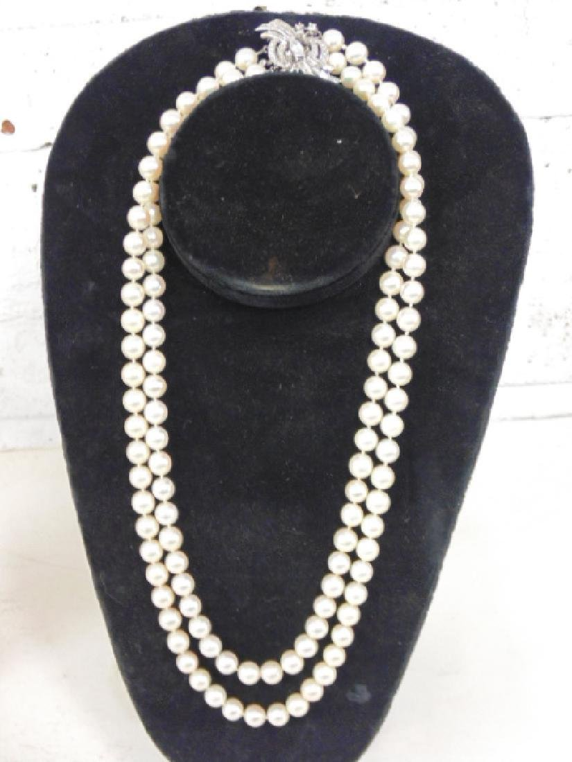 Double strand pearl necklace, diamond & gold clasp.