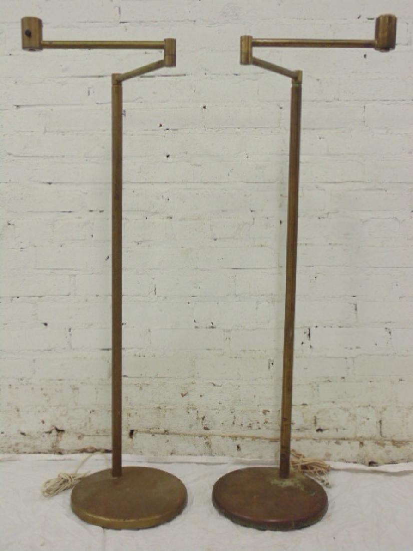 Pair Walter von Nessen brass swing arm floor lamps