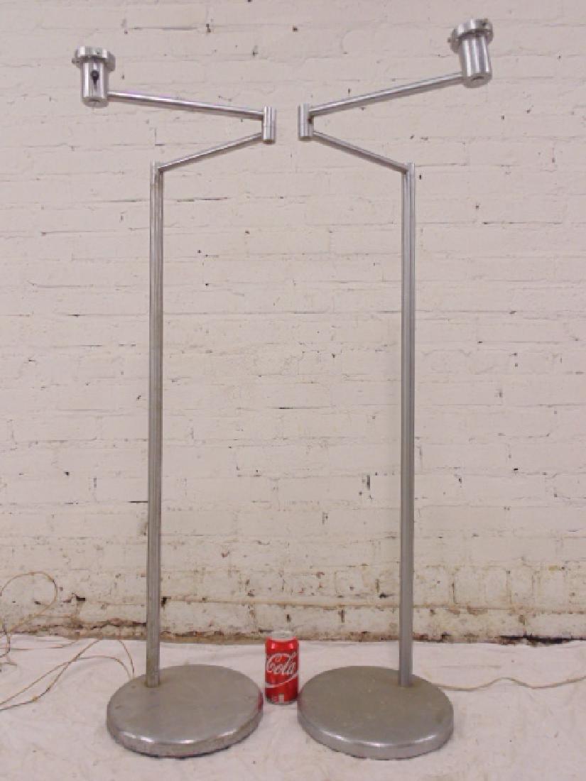 Pair Walter von Nessen swing arm floor lamps