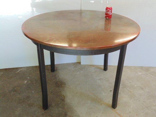 "Round, copper top table, metal legs, base, 42"" diameter"