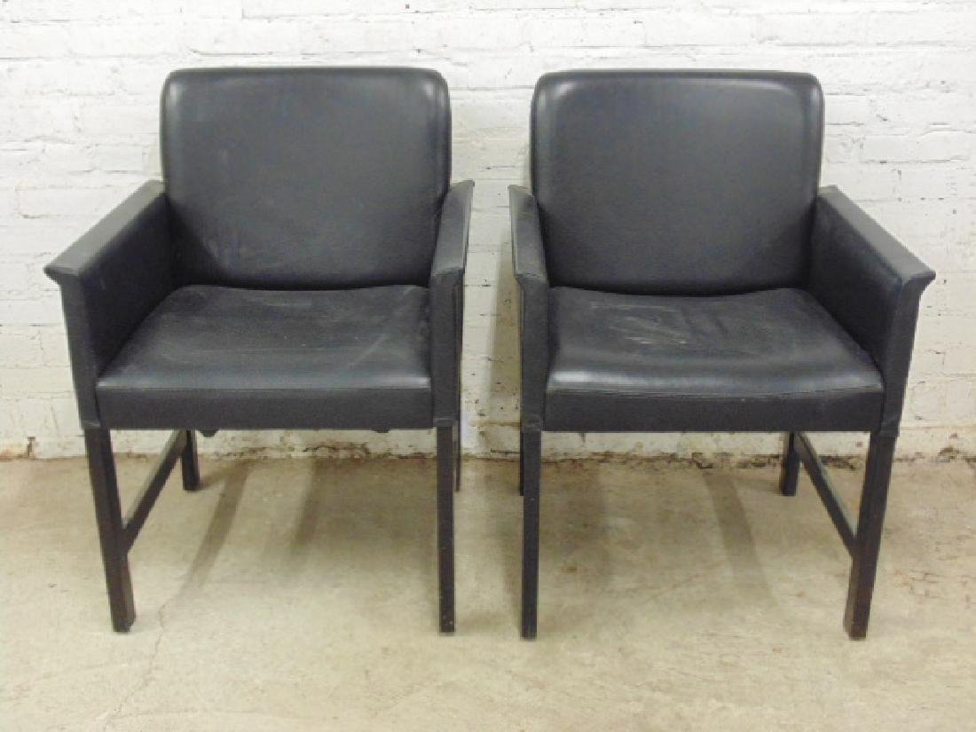Pair black leather arm chairs by Hans Olesen